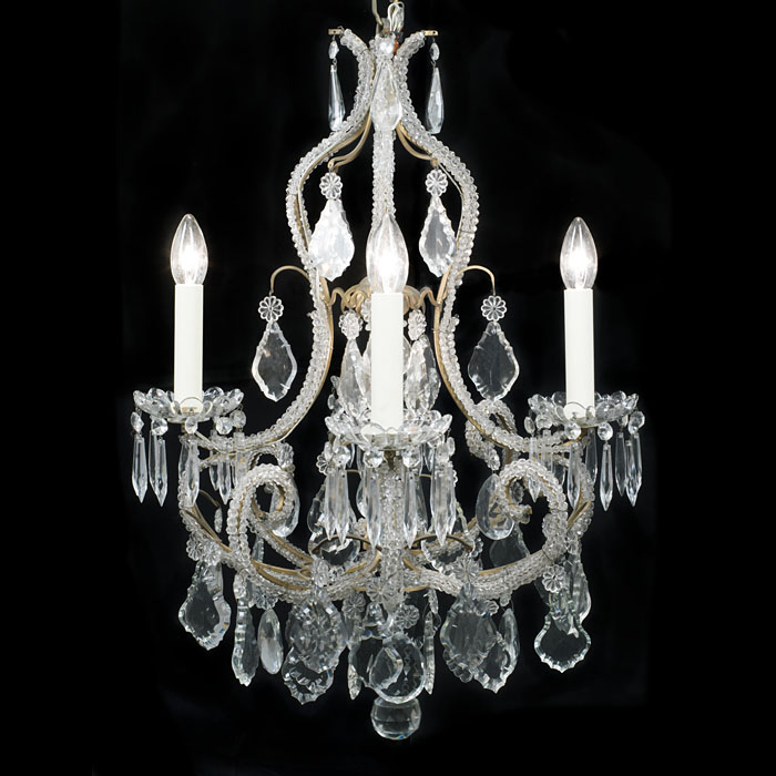 A 20th century small crystal four branch chandelier