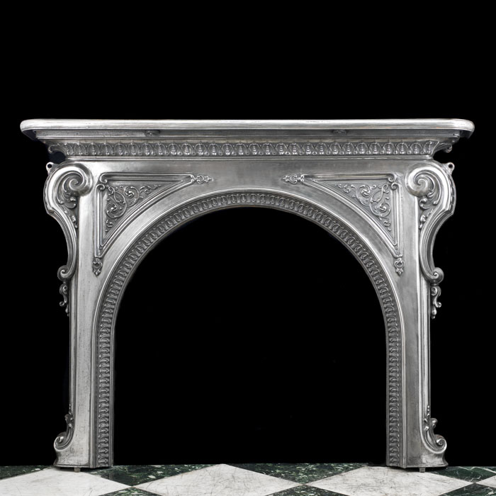 A Cast Iron Rococo Style Fireplace Mantel