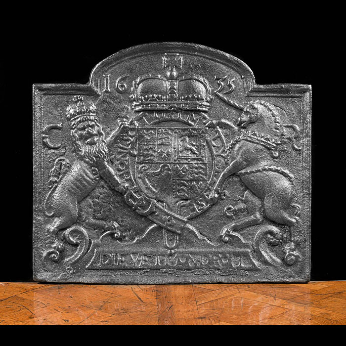 An English fire back in cast iron, with Royal coat of arms.