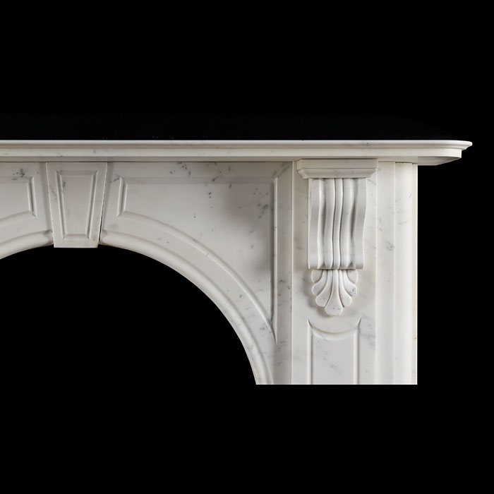 A Victorian arched fireplace surround in white statuary marble