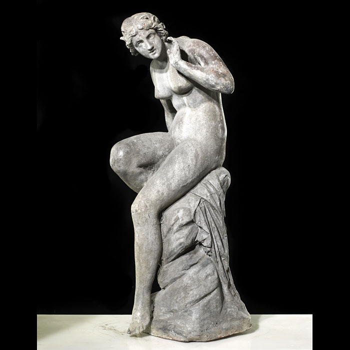 An antique lead statue of a Water Nymph