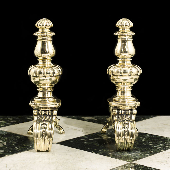 A pair of brass antique Baroque chenets andirons