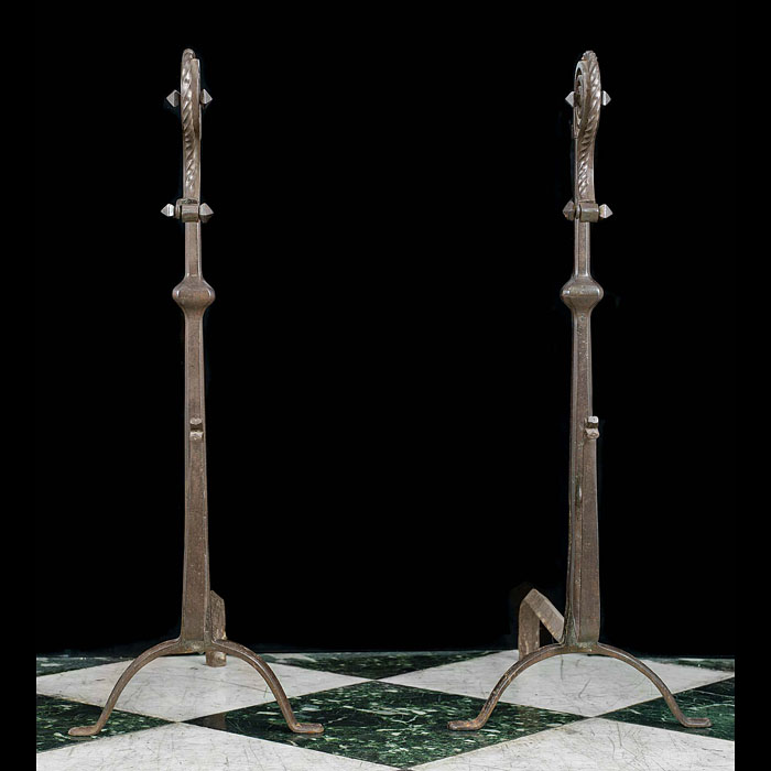 An Antique pair of Jacobean style wrought iron andirons
