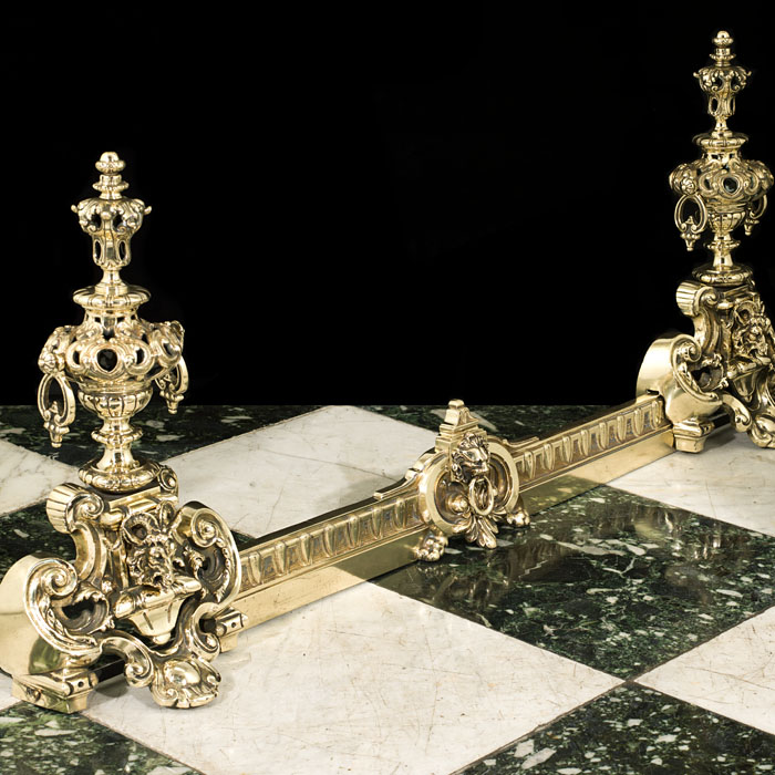 A pair of Louis XIV style brass chenets & fender bar
