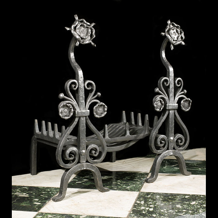 An antique pair of wrought iron Arts & Crafts andirons