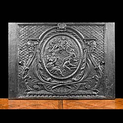 A 17th century large antique French cast iron fireback.