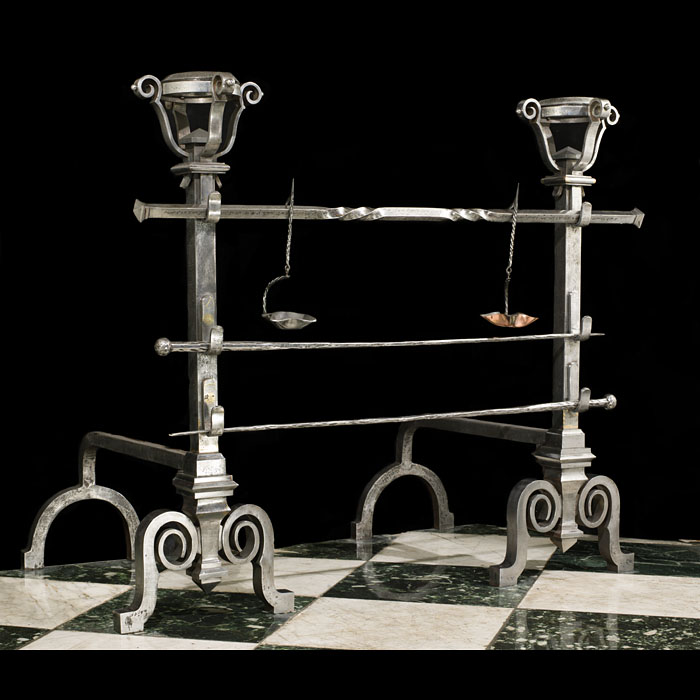 A pair of large antique wrought iron andirons