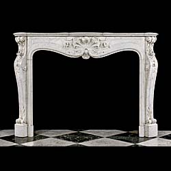 14083: A finely carved Carrara Marble Louis XV Rococo style chimneypiece, the scrolled and panelled frieze centred by an elaborate foliate cartouche surrounded by delicate trailing flowers, the whole support