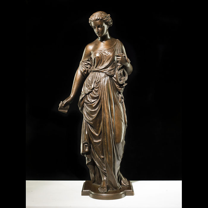 An Antique French bronze model of a muse