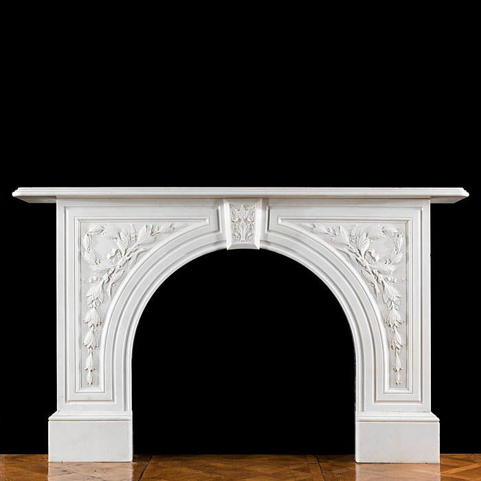 An antique Victorian arched marble fireplace surround