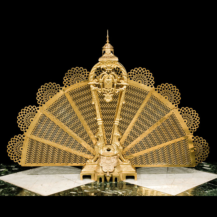 An Antique Gilt Brass Peacock Fire Screen.