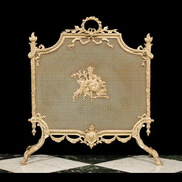 14117: A fine Louis XV style gilt brass firescreen centred with a decorative quiver and bagpipes, surrounded by tied ribbon swags and raised on scrolled leaf and hoof feet.French mid 20th century.     Link t