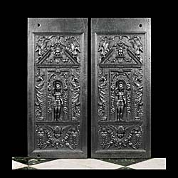 A pair of antique fireplace back panels