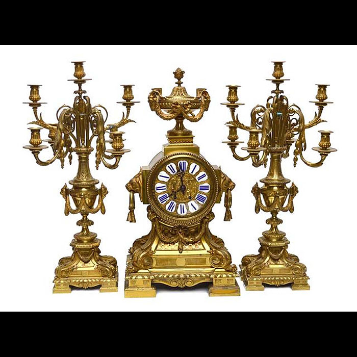 A Louis XVI style large antique clock garniture