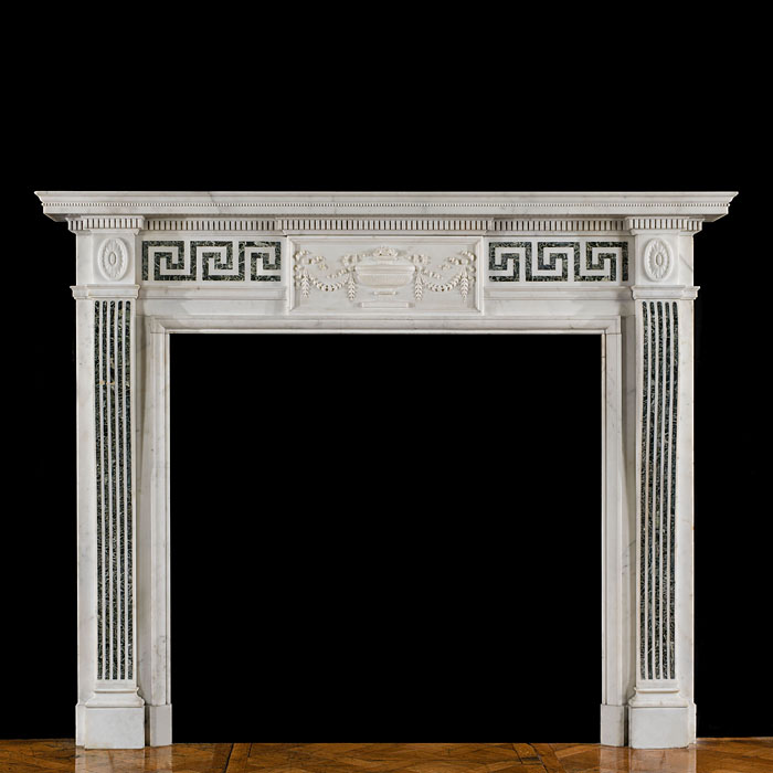 14147: A refined and elegant Edwardian Neoclassical style antique fireplace, in white statuary and Verdi Antico marble. The central plaque is decorated with a finely carved urn surrounded by bell flower swag
