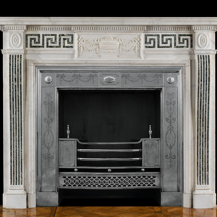 An antique Neoclassical style marble chimneypiece.