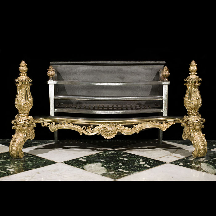 An Antique Rococo brass and cast iron fire basket
