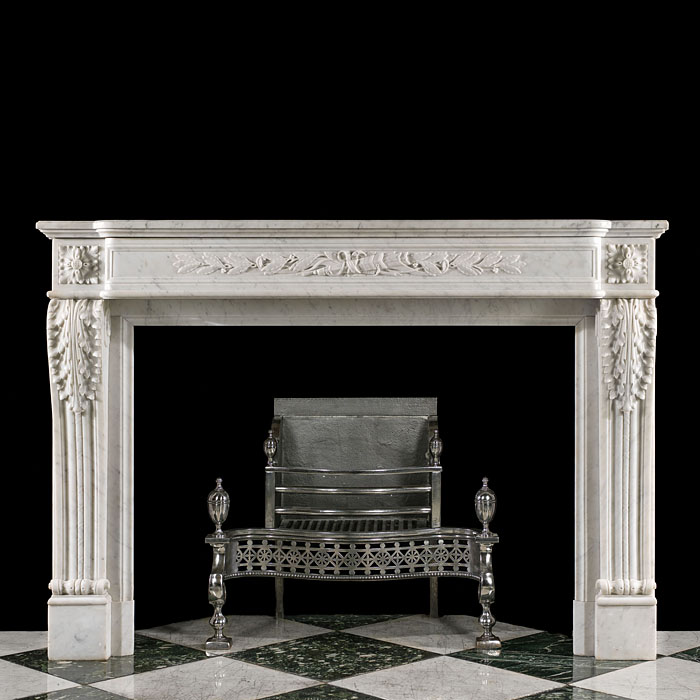 An antique Louis XVI style fireplace mantel