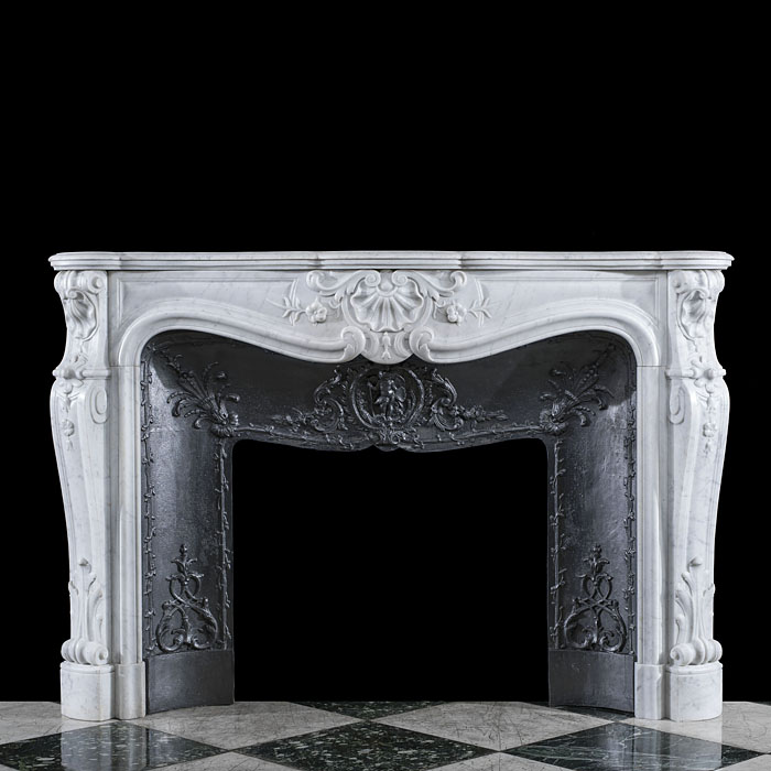 A Carrara Marble Louis XV chimneypiece