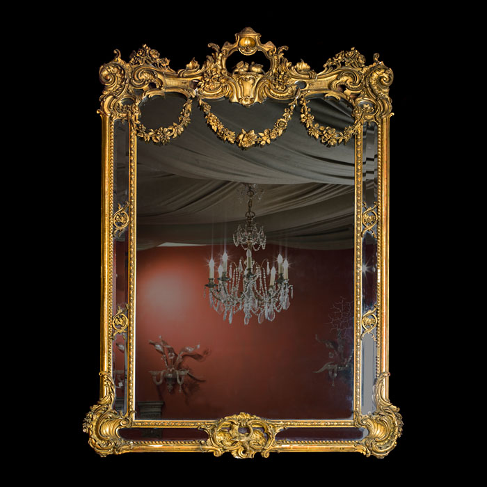 A Louis XV Style Giltwood Overmantel Mirror