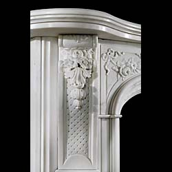 An antique Statuary Marble Rococo style fireplace surround