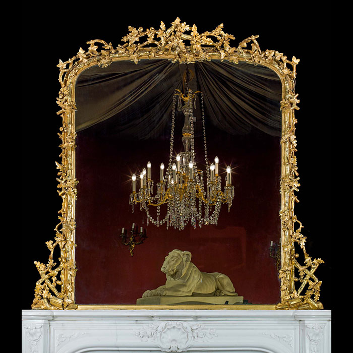 An English gilded oak and ivy decorated over mantel mirror