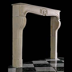 A French Regency antique limestone chimneypiece