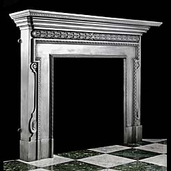 A large cast iron Georgian style antique fireplace mantel