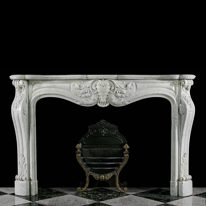 A French Rococo Carrara Marble Fireplace