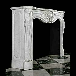A French Rococo style white Carrara Marble antique fireplace
