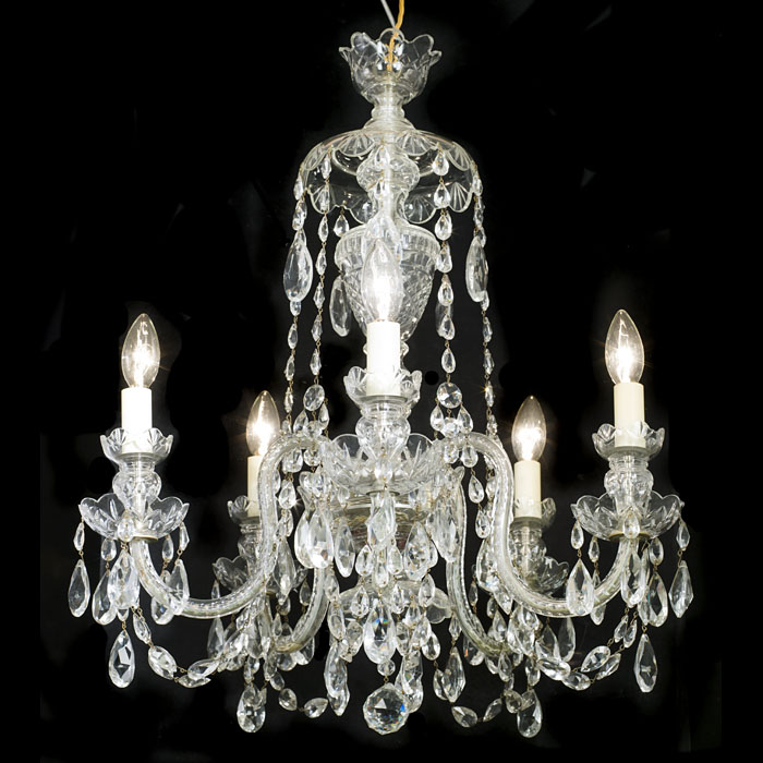 A cut glass 20th century five branch neoclassical style chandelier