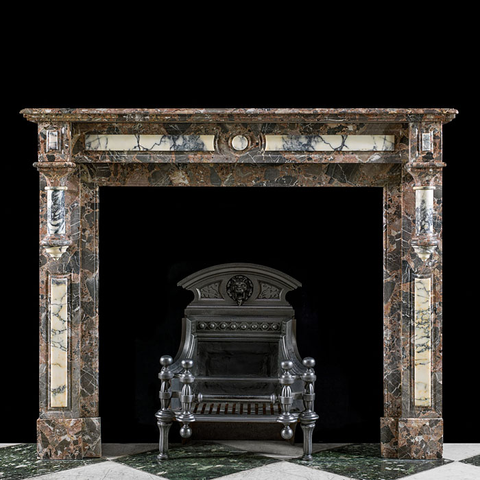 An antique Gothic Revival marble fireplace surround