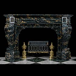 A large Portoro Marble Barque style antique fireplace surround