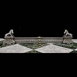 An antique French cast iron and brass boar fireplace fender