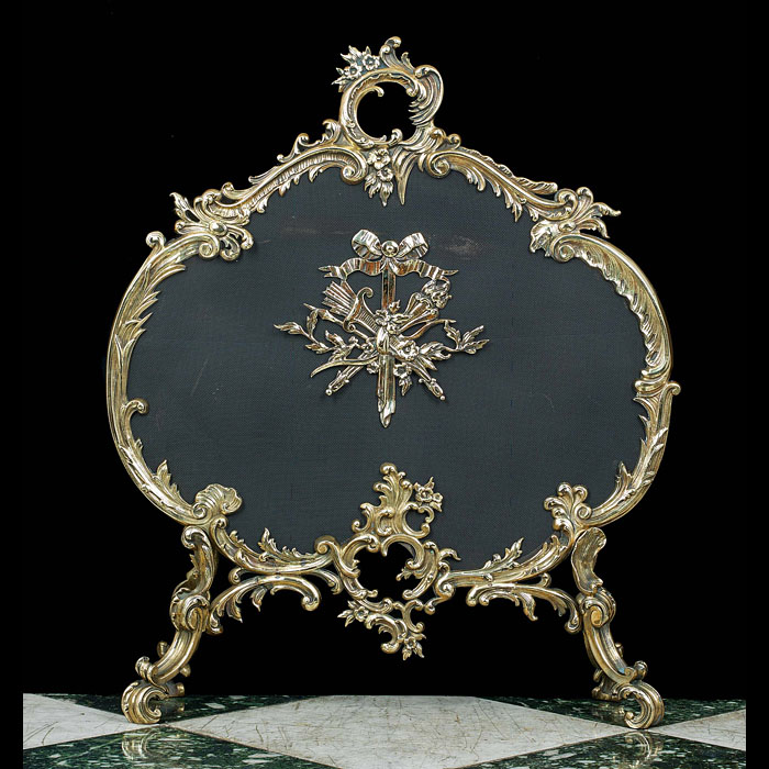 An antique gilt brass Rococo fire screen