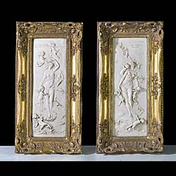 A pair of 19th century marble resin plaques