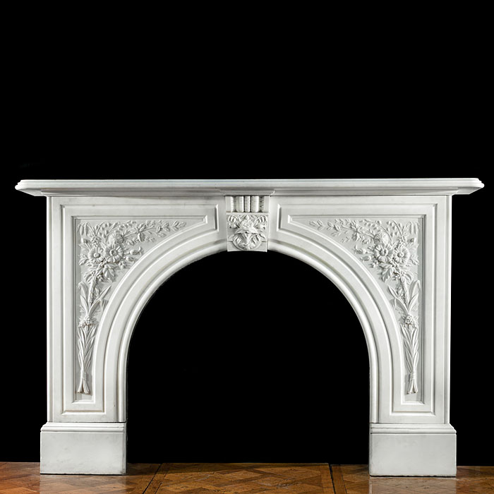 A Victorian arched marble antique fireplace