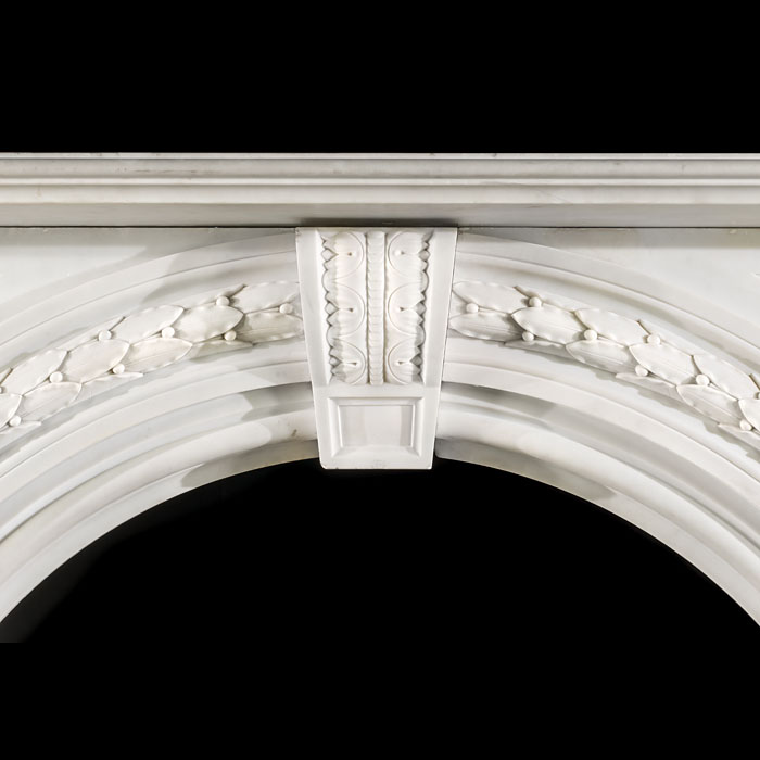 A large Victorian arched antique marble fireplace surround
