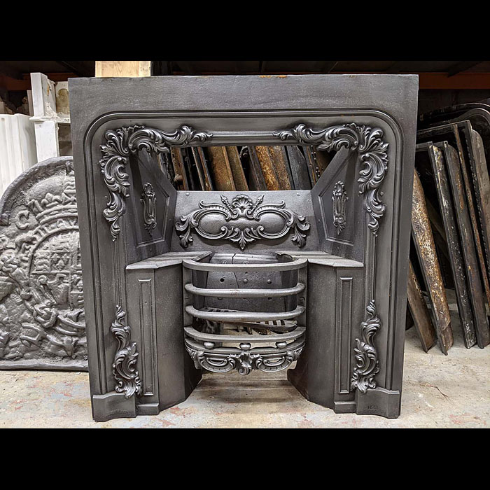 Acanthus embellished cast iron antique fireplace insert