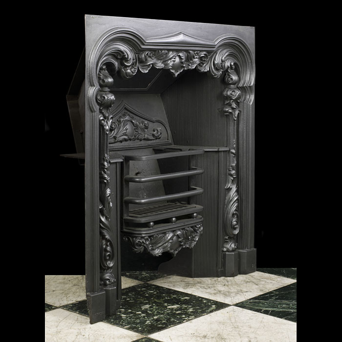 An antique cast iron Georgian insert