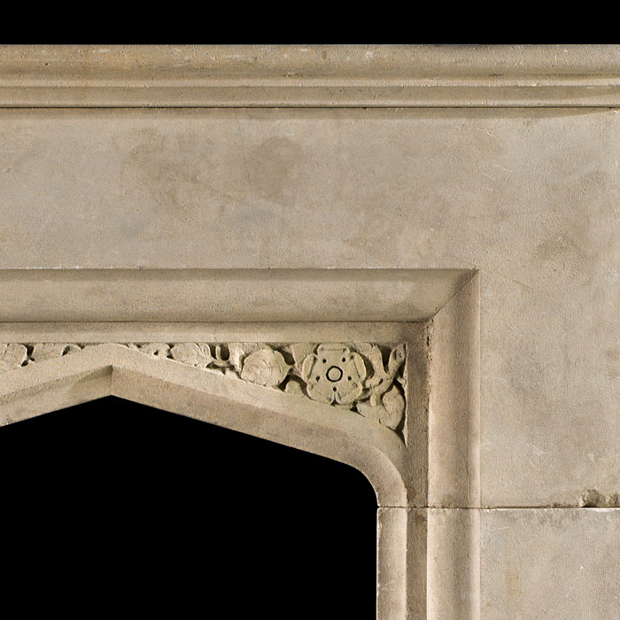 A Tudor Revival antique Victorian limestone fireplace mantel
