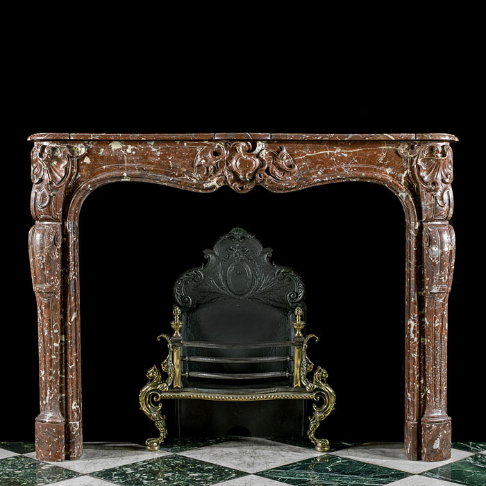 An antique French Rouge Royale marble chimneypiece