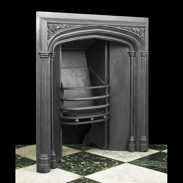 A Victorian cast iron antique fireplace insert