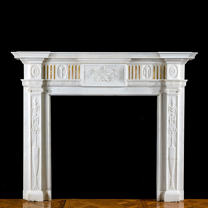 A Statuary and inlaid Sienna Marble antique chimneypiece