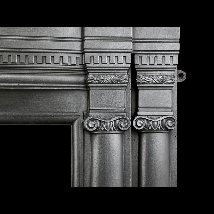 A large cast iron antique Victorian fireplace surround.