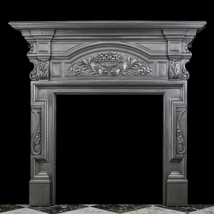 An antique cast iron tall Victorian fireplace mantel