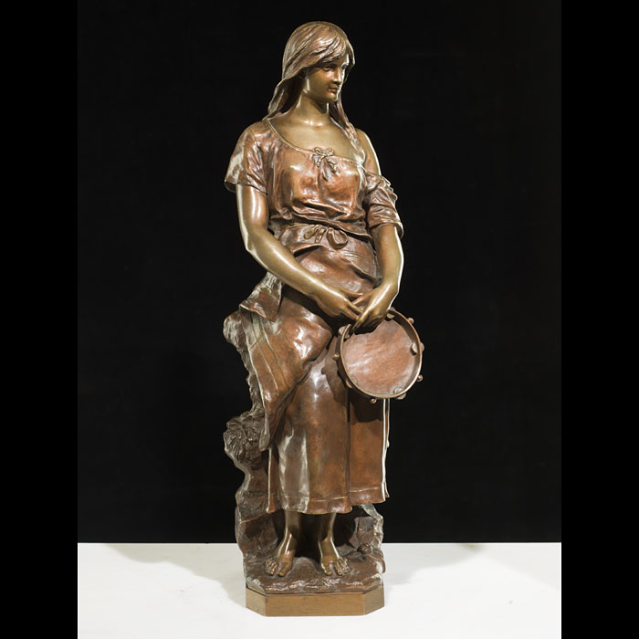 A bronze 20th century model of a gypsy girl with tambourine