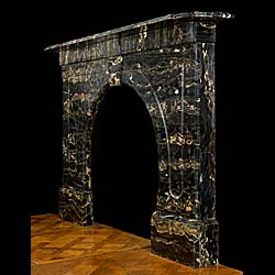 A Victorian Portoro Marble antique arched fireplace surround