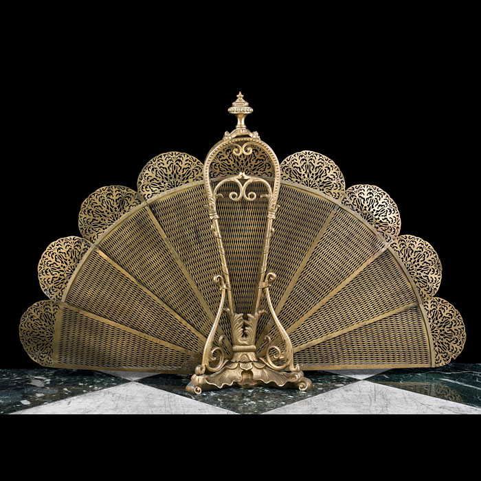A Rococo style gilt metal peacock fan shaped fire screen