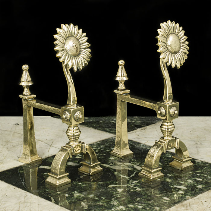 A pair of French brass antique firetool rests or fire dogs